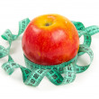 Stock Photo: Diet red apple and measuring tape
