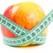 Diet red apple and measuring tape isolated — Stock Photo