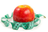 Red apple and tape — Stock Photo