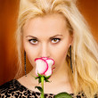 Portrait of a beautiful girl with a rose — Stockfoto