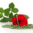 Red rose flower and beads — Foto Stock