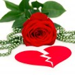 Rose with hearts and beads — Stock Photo