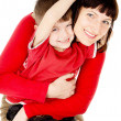 Mom hugging with a small child — Stock Photo #28689179