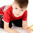 A little boy draws on the paper — Stock Photo