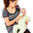 The mother feeds her baby — Stock Photo #28689329