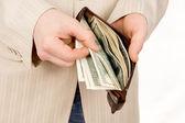 Człowiek liczy się pieniądze portfel — Zdjęcie stockowe