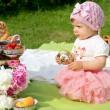 Beautiful little girl at picnic, outdoors — Zdjęcie stockowe