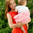 Happy mother holding a baby — Stock Photo