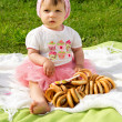 Stock Photo: Little girl on a picnic