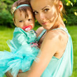 Stock Photo: Mom holding baby in her arms