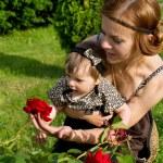 Mom shows flower child — Stock Photo #31397799