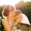 Mother hugging baby — Stock Photo
