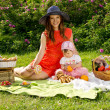 Picnic, a young mother with a baby — Stock Photo