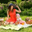 Stock Photo: Picnic, mom and baby on nature