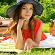 Stock Photo: Portrait of a girl in a hat on a picnic