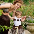 Stock Photo: Young mother with baby stroll