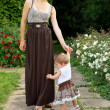 Young mother walks with the child — Stock Photo #31398089