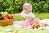 A small child resting on a picnic — Stock Photo