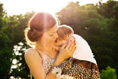 Mother hugging baby — Stok fotoğraf