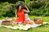 Picnic, mom and baby on nature — Stok fotoğraf