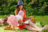Picnic, mother and daughter resting — Stock Photo