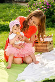 Picnic, mother feeds her baby — Stock Photo