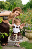 Young mother with baby stroll — Stock Photo
