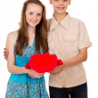 A guy and a girl holding heart — Stock Photo