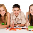 Happy young students with books — Stock Photo
