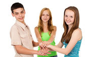 A group of young people holding hands — Stock Photo