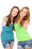 Young sisters show sign ok — Stock Photo