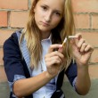 Young girl broke her cigarette — Stock Photo
