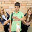 Young people against smoking in the street — Stock Photo #33513365