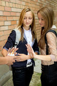 Schoolgirls indicate stop smoking — Stock Photo