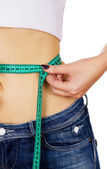 Slim girl measure its waist and shows OK — Stock Photo