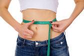 Slim girl measure its waist — Stock Photo