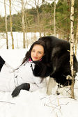 Siberian Laika and girl in winter — Stock Photo