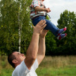 Father throws to the top the son — Stock Photo #39889759