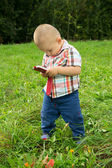 A little boy playing with the phone — Stock Photo