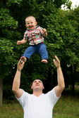 Father throws to the top the son — Stock Photo