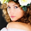 Portrait of a beautiful girl with a bouquet of flowers on the he — Stock Photo #39890095