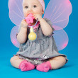 Stock Photo: Baby with wings and toy