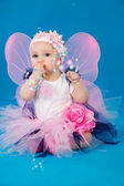 Baby and soap bubbles on a blue background — Stock Photo