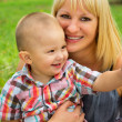 Mother is holding her son in her arms — Stock Photo #42872227