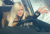 Blonde in road angry — Stock Photo