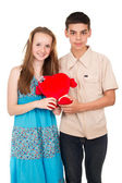 In love young couple with a heart — Stock Photo