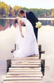 Young couple kissing on the bridge — Stock Photo