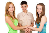 Young people holding hands — Stock Photo