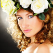Portrait of a beautiful girl with a bouquet of flowers on the he — Stock Photo #45290873