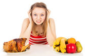 Beautiful girl thinks before choosing food — Stock Photo